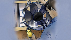 En una apertura de rejilla en el ático, asegure el ventilador atornillando sus soportes de montaje en los montantes.
