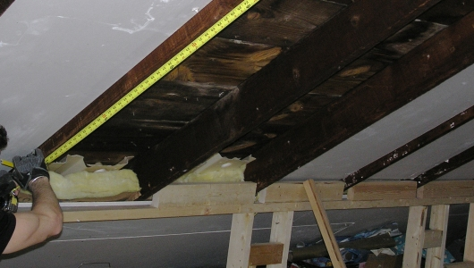 Installing skylights in an occupied attic