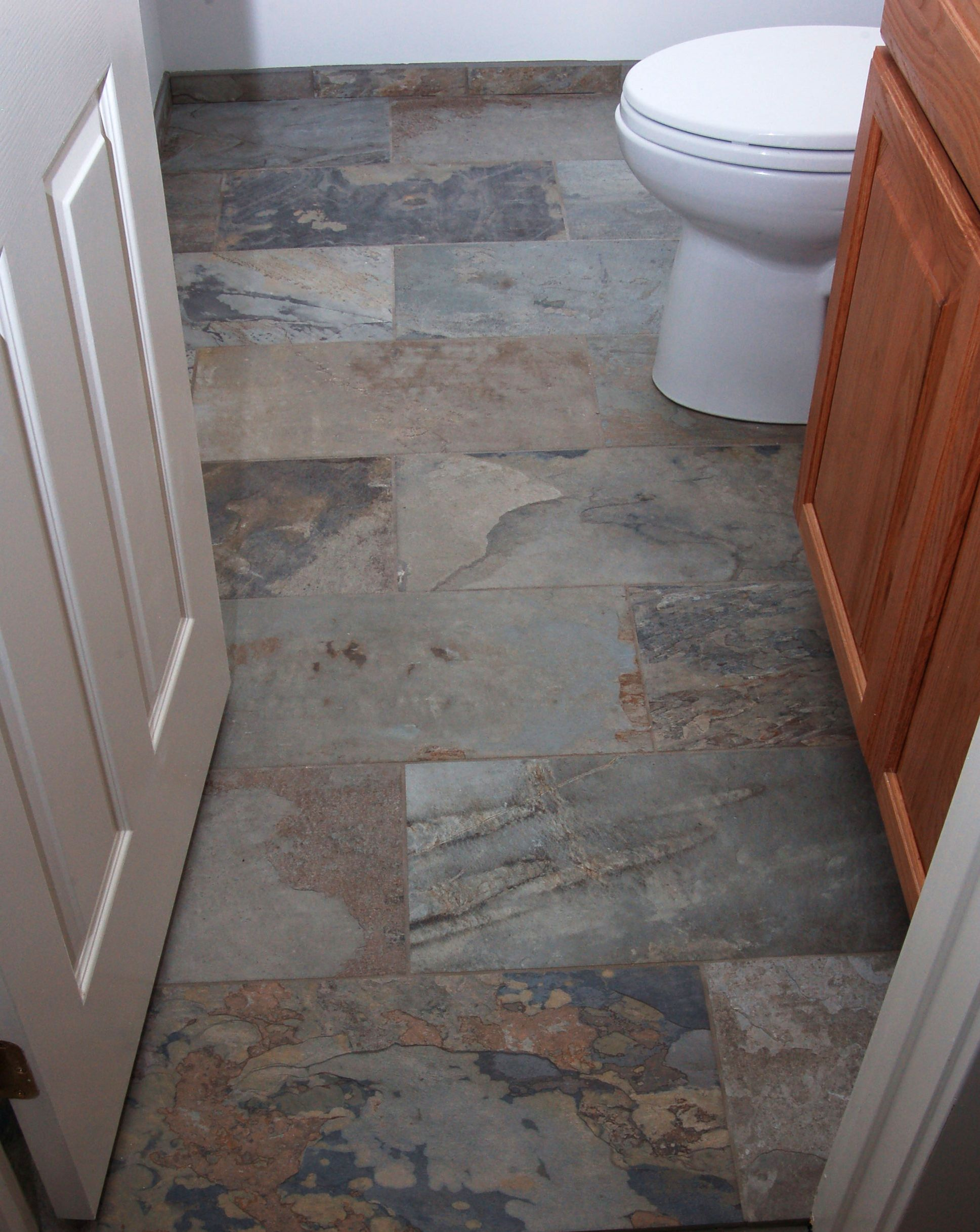 floor tile debate stone vs porcelain