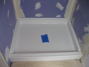 Preparar una ducha para colocar las baldosas